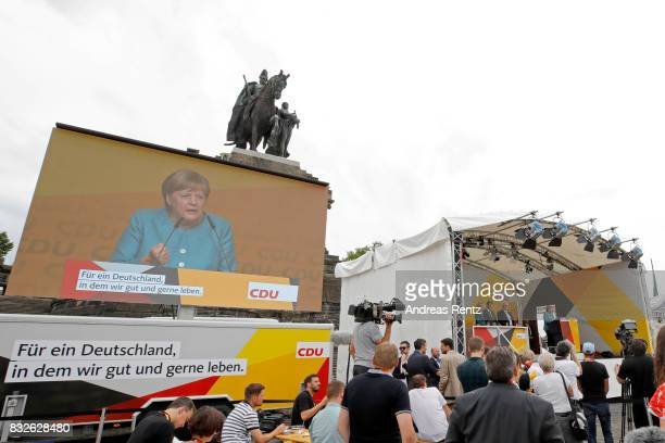 A general view while German Chancellor and head of the German Christian Democrats Angela Merkel speaks on stage at an election rally at the headland...