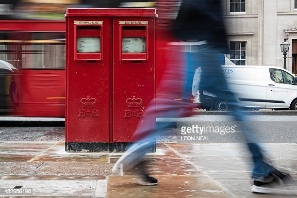 General views of a 1970s 'Type G' pillar box still in use by the Royal Mail in central London England on 24 July 2015 AFP PHOTO/Leon Neal