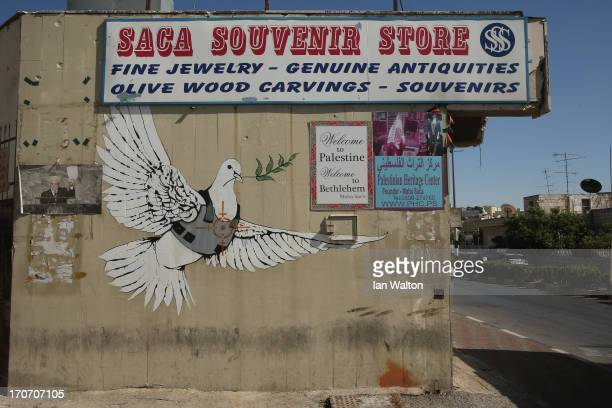 General views of a Banksy wall painting on the apartheid wall near Bethlehem on June 16 2013 in central West Bank