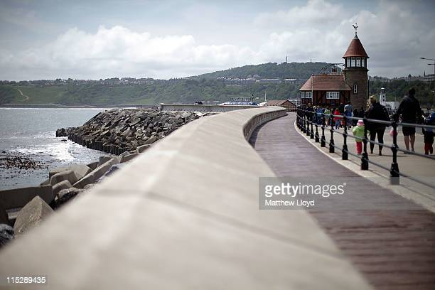 General views of Scarborough's sea wall that protects Marine Drive the coastal road from the North bay to the South Bay from rising sea levels and...