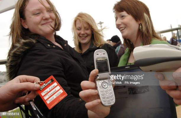 General views of the crowd having their textmessage barcode tickets scanned at Liverpool's Pierhead where the Zutons are to perform a Vodaphone Live...