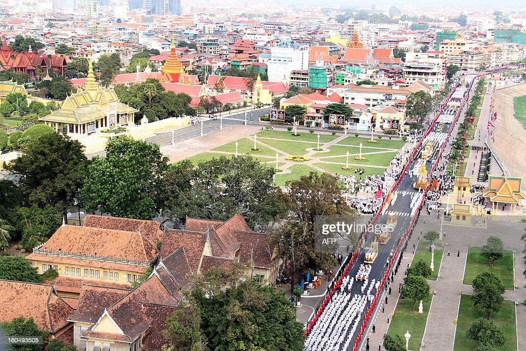 A general views of the Royal floats in front of the Royal Palace during a funeral procession for the late former King Norodom Sihanouk in front of the Royal Palace in Phnom Penh on February 1, 2013. A sea of mourners filled the streets of the Cambodian capital Friday for a lavish funeral for revered former king Norodom Sihanouk, who towered over six tumultuous decades in his nation's history. AFP PHOTO/ Khem Sovannara