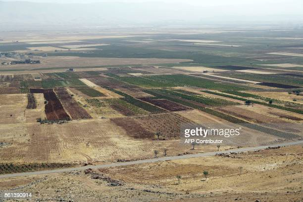 A general views of vineyards planted next to cannabis fields on the outskirts of Deir alAhmar in the Beakaa Valley one of the poorest regions in...