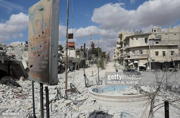 TOPSHOT A general views shows a severely damaged street in the northwestern border town of alBab on February 24 2017 after Turkishbacked rebels...