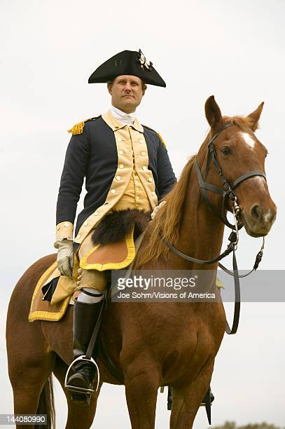 General Washington looks over his troops prior to march from camp to the Surrender Field at the 225th Anniversary of the Victory at Yorktown a...