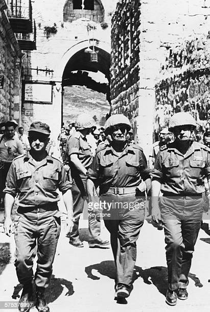 General Yitzhak Rabin and a group of soldier entering the Old City through the Lion's Gate after taking control of Jerusalem and the territories...