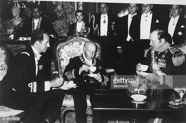 Generalissimo Francisco Franco Spain's chief of state plays host to Prince Juan Carlos and visiting Paraguayan President General Alfredo Stroessner...
