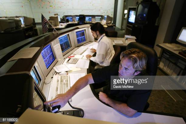 Generation Dispatcher Travis Keller and Transmission Dispatcher Lee Recchia help manage the flow of electricity in the control center of the...