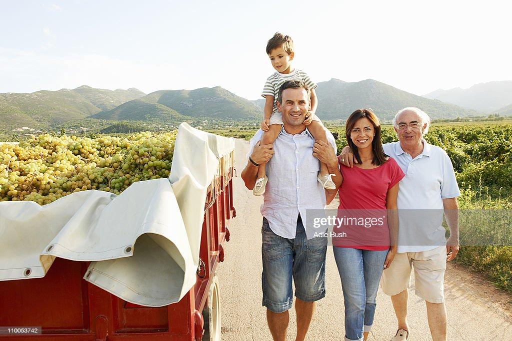 Generational family walking in vineyard
