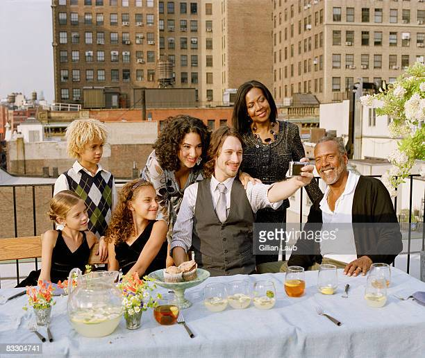 Generations of family having dinner on rooftop.