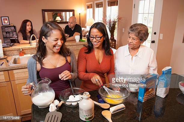 3 generations of Hispanic women cooking at home