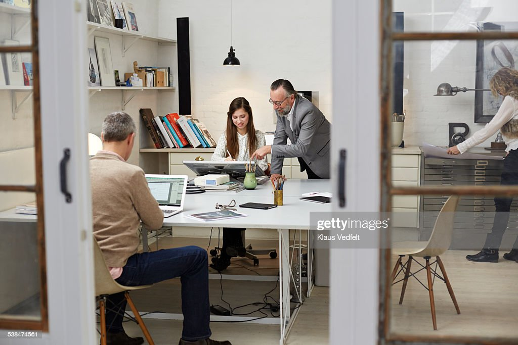3 generations working at small design agency : Stock Photo