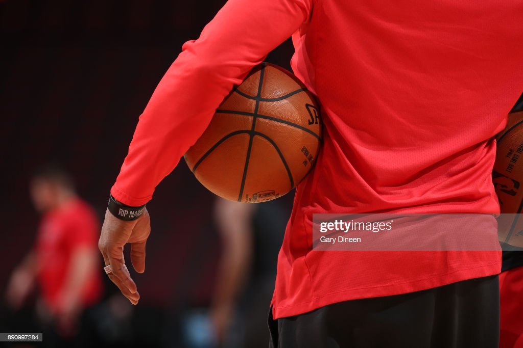 A generic basketball photo of a trainer holding the Official @NBA Spalding basketball before the Boston Celtics game against the Chicago Bulls on December 11, 2017 at the United Center in Chicago, Illinois.