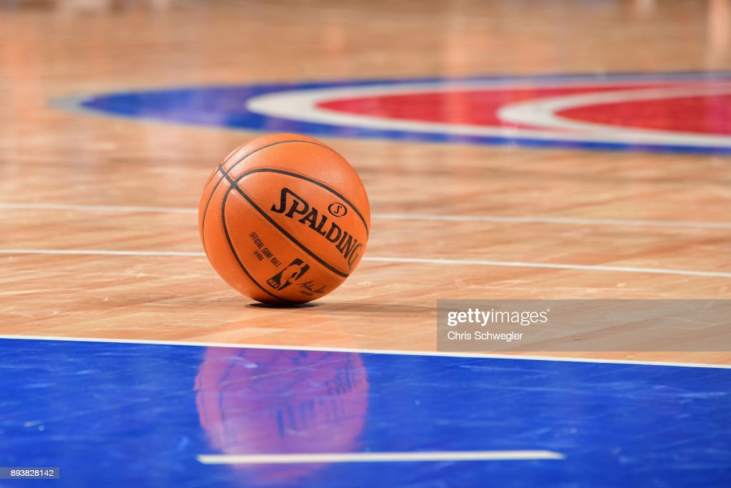 A generic basketball photo of the Official @NBA Spalding basketball on the court during the Golden State Warriors game against the Detroit Pistons on December 8, 2017 at Little Caesars Arena in Detroit, Michigan.