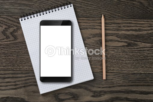 Generic Modern Smartphone On Notepad With Pencil Stock Photo