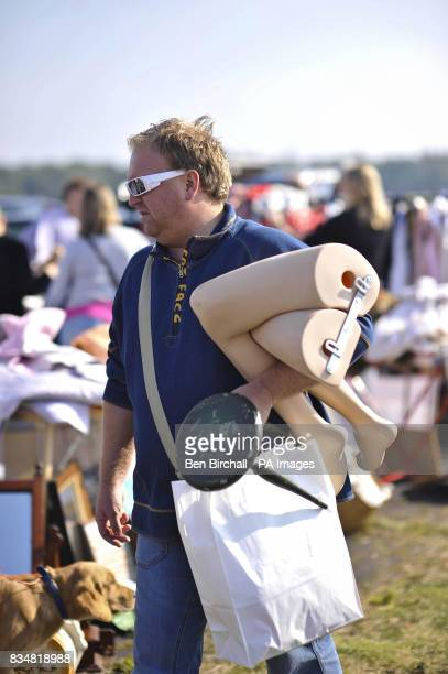 Generic picture of a man carrying a mannequin at a car boot sale at Manor Farm Chedworth Gloucestershire