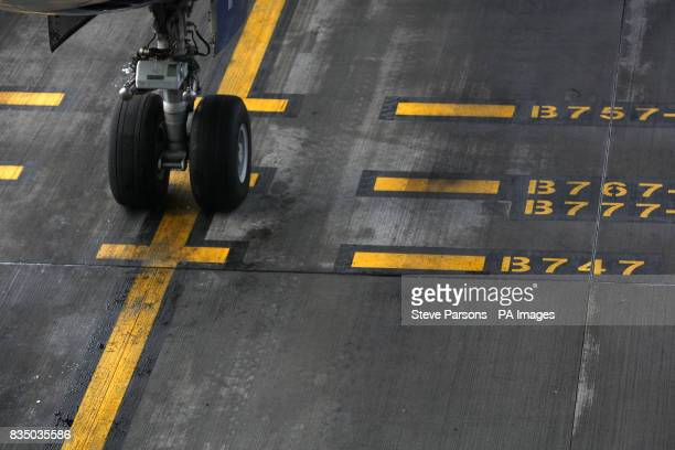 Generic picture of a plane's wheels on the tarmac at Terminal 5 Heathrow Airport