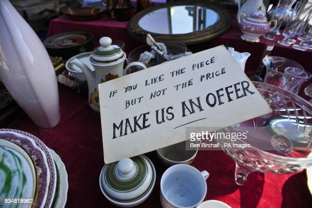 Generic picture of a sign saying 'if you like the piece but not the price make us an offer' at a car boot sale at Manor Farm Chedworth Gloucestershire