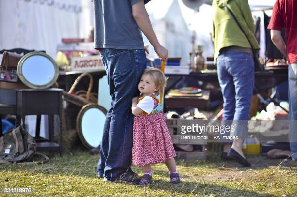 Generic picture of an unidentified baby girl at a car boot sale at Manor Farm Chedworth Gloucestershire