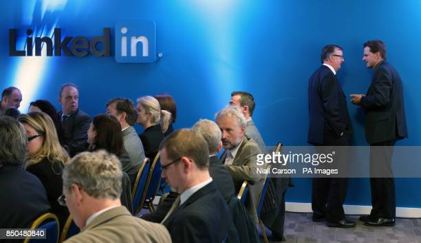 A generic picture of business people near the LinkedIn logo in LinkedIn's offices in Gardner House Wilton Place Dublin