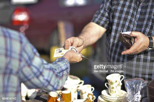 Generic picture of money exchanging hands at a car boot sale at Manor Farm Chedworth Gloucestershire