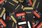 32 GB generic SD card front and back piled on top of each other