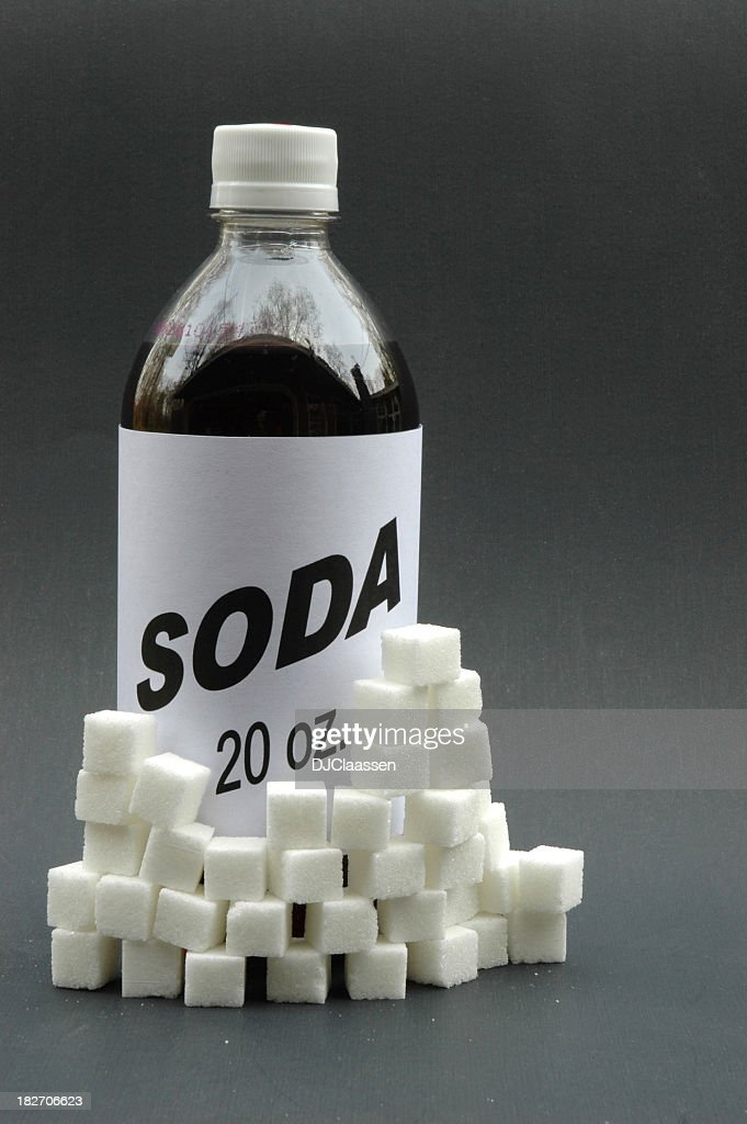 Generic soda with sugar cubes stacked around it