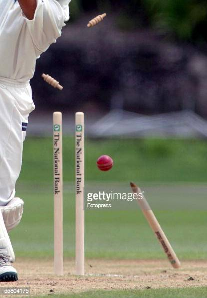 Generic Sport Image Wickets and stumps fly in the air as a Cricketer is bowled