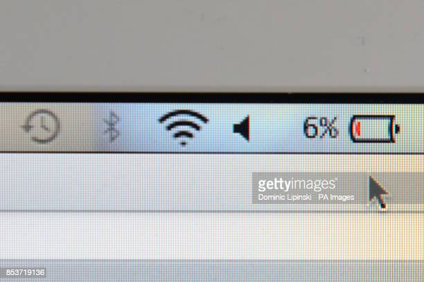 Generic stock photo shows a laptop screen displaying a low battery symbol
