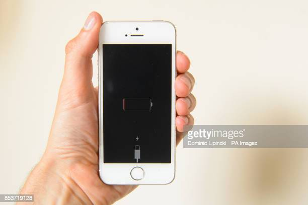 Generic stock photo shows an iPhone smartphone displaying a low battery warning