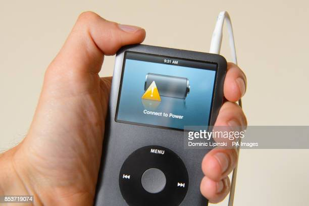 Generic stock photo shows an ipod mp3 player displaying a low battery warning