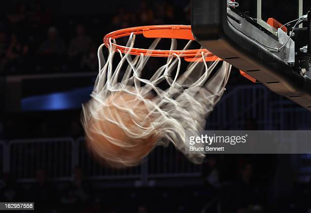 A generic view of a basketball going through the hoop during practice prior to the game between the Brooklyn Nets and the Dallas Mavericks at the...