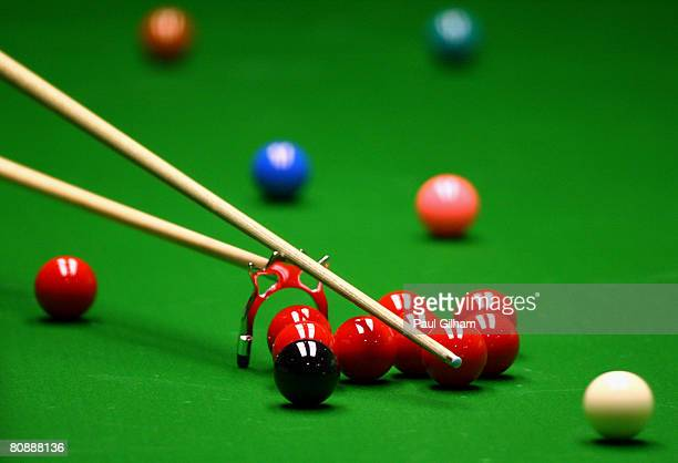 A generic view of the white ball being struck by the cue using the bridge during day ten of the 888com World Snooker Championships at the Crucible...