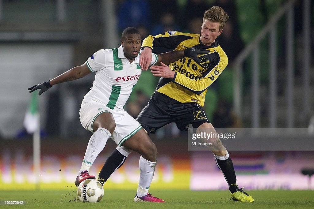 Genero Zeefuik of FC Groningen, Kees Luijckx of NAC Breda during the Dutch Eredivisie match between FC Groningen and NAC Breda at the Euroborg on march 08, 2013 in Groningen, The Netherlands