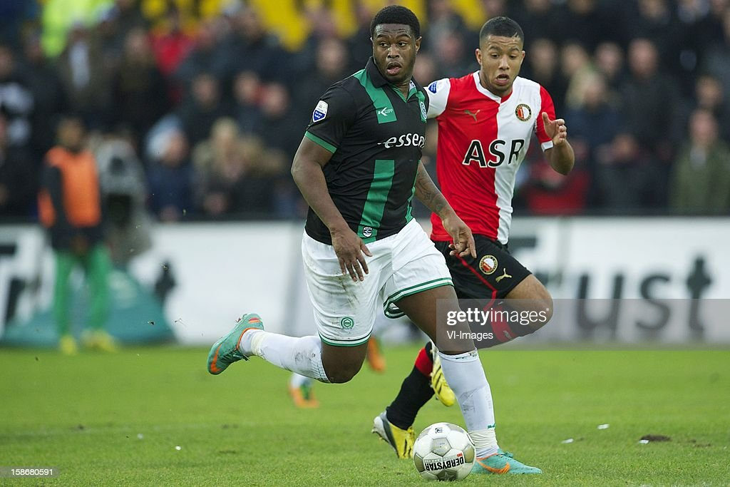 Genero Zeefuik of FC Groningeng, Tonny Vilhena of Feyenoord during the Dutch Eredivise match between Feyenoord and FC Groningen at stadium De Kuip on December 23, 2012 in Rotterdam, The Netherlands.