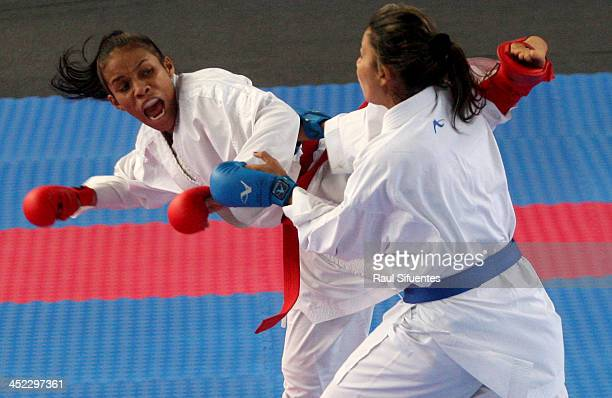 Genesis Navarrete of Venezuela and Stella Urango of Colombia compete in women's karate 55kg finals as part of the XVII Bolivarian Games Trujillo 2013...