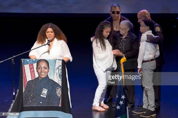 Genesis Villella left and twins Delilah and Peter Vega children of New York City Police Officer Miosotis Familia and her mother Adriana Valloy...