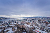 Geneva, Switzerland - December 18, 2017 : View of Geneva Downtown District, taken from the Cathedral Tower. As Geneva is in plain, it is quite rare to see its city center covered with snow. When this