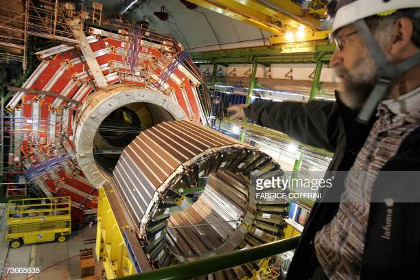A engineer faces 22 Mars 2007 near Geneva the magnet core of the world's largest superconducting solenoid magnet one of the experiments preparing to...