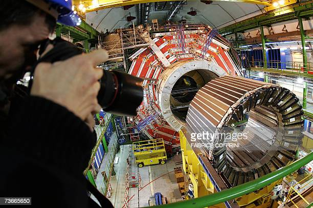 A press photographer photographes 22 Mars 2007 near Geneva the magnet core of the world's largest superconducting solenoid magnet one of the...