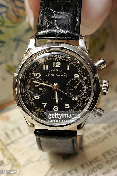 An employee of auction company Antiquorum displays 10 May 2007 in Geneva a Rolex watch sold to a prisoner of war during World War II with the...
