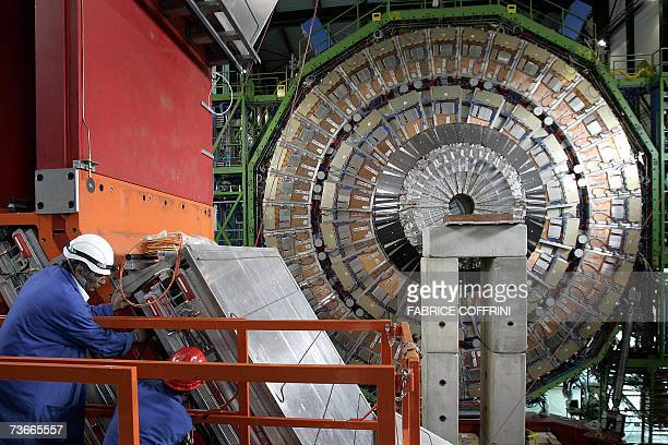 Engineer works to assemble 22 Mars 2007 near Geneva one of the layers of the world's largest superconducting solenoid magnet one of the experiments...