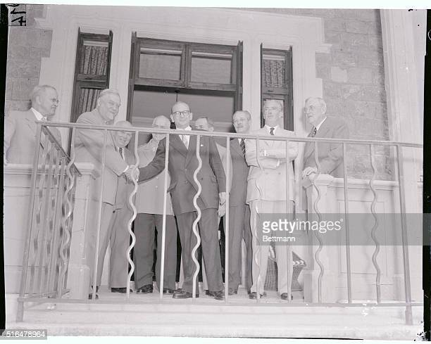Handshake At The Summit Soviet Premier Nikolai Bulganin second from left and French Premier Edgar Faure shake hands as they posed on the balcony of...