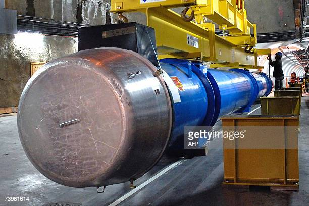 This picture provided by the European Organization for Nuclear Research shows a large dipole magnet symbolically lowered into the tunnel 26 April...