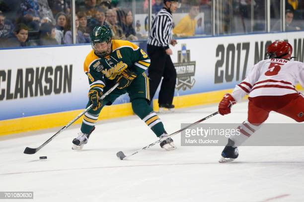 Genevieve Bannon of Clarkson University attacks against the University of Wisconsin during the Division I Women's Ice Hockey Championship held at The...