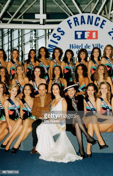 Genevieve de Fontenay organizer of the Miss France beauty pageant is surrounded by the 43 candidates for the Miss France 2000 pageant at the Hotel de...