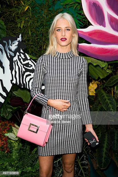 Genevieve Garner arrives at Roger Vivier Summer Party at Loulou's on May 22 2014 in London England