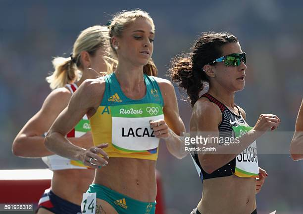 Genevieve Lacaze of Australia and Andrea Seccafien of Canada compete during the Women's 5000m Round 1 on Day 11 of the Rio 2016 Olympic Games at the...