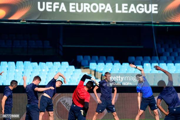 KRC Genk players take part in a training session at the Balaidos stadium in Vigo on April 12 on the eve of their UEFA Europa League quarter final...