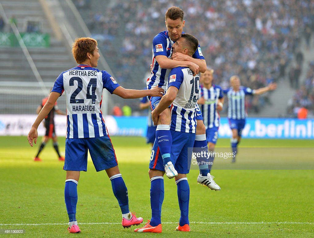 Genki Haraguchi, Alexander Baumjohann and Vedad Ibisevic of Hertha BSC celebrate after scoring the 3:0 during the Bundesliga match between Hertha BSC and Hamburger SV on October 3, 2015 in Berlin, Germany.